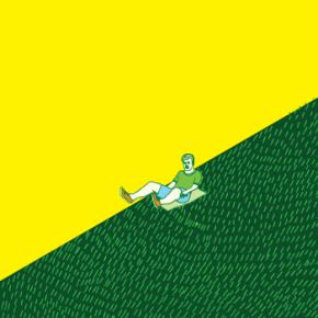 Cartaz: Pessoas escorregam de papelão no gramado do congresso