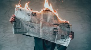 a-man-read-burning-newspaper