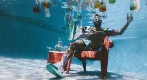 Man sitting on chair underwater