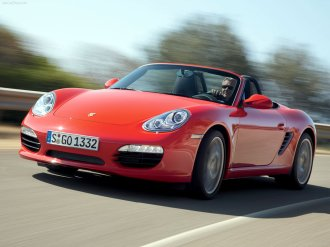 2009 Guards Red Porsche Boxster S wallpaper Front angle view