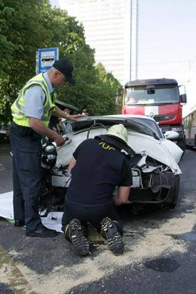 Girl crashes Porsche Cayman in Riga Latvia