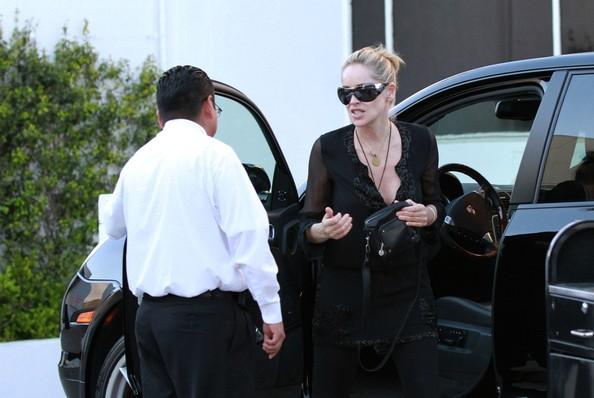 Photo of Sharon Stone and black Porsche Cayenne