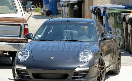 dj Sam Ronson and  Black Porsche 911 Targa