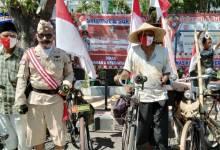 Photo of Agustusan, Komunitas Sepeda Ontel Situbondo ikuti Upacara Bendera
