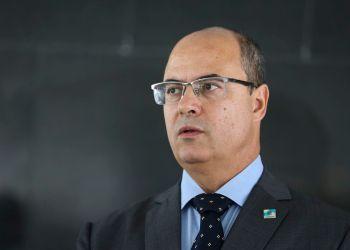 O governador do Rio de Janeiro, Wilson Witzel, fala à imprensa após reunião com o presidente da República, Jair Bolsonaro, no  Palácio do Planalto.