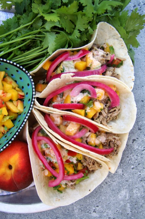 Jerk Chicken Tacos with Peach-Mango Salsa, Pickled Red Onions & Spiced Yogurt