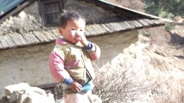 young boy on the trekkers route up to Namche Bazaar