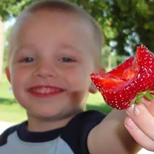 kid with strawberry