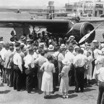 A THRONG OF ADORING FANS AWAIT AMELIA EARHART AS SHE LANDS IN NEWARK IN 1932