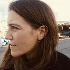 Porth customer wearing silver circle stud earrings