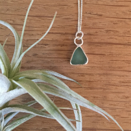 Bespoke seaglass necklace. The seaglass is a turquoise triangle