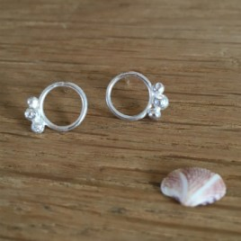Circle and silver pebble studs.