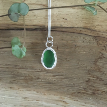 Emerald-Green Beaded Seaglass Necklace - Gyllyngvase. This green seaglass has a beaded detail around the edge in silver.