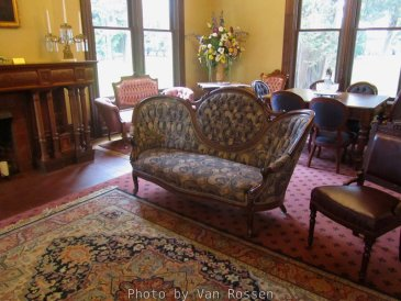 The furnishings are not original but are period pieces.