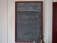 Blackboard at the ranger station shows which working buildings are open and staffed by volunteer reenactors.