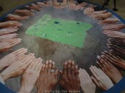 A circle of hands show the diversity of the ethic population that make up Oregon.