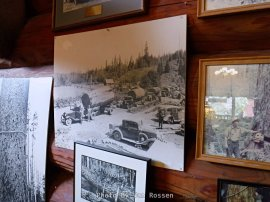 The wall are covered with old photos and artifacts from the early days of logging.