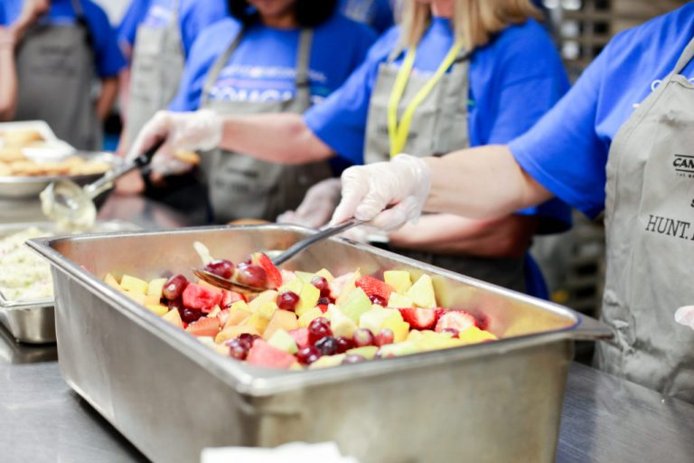 Hunt Fish Feed helps serve dinner to the homeless at Portland Rescue Mission Burnside Shelter