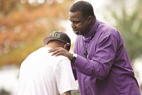 PAMPLIN MEDIA GROUP PHOTO: JAIME VALDEZ - Clifford Jones, pastor at Sonrise Church in Hillsboro, prays with a man before a recent church service for ex-convicts.