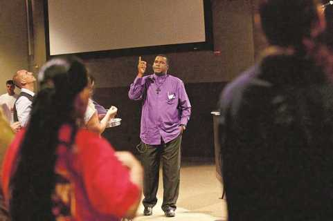 Pastor Clifford Jones leads a worship service for ex-convicts at Sonrise Church on a recent Sunday.