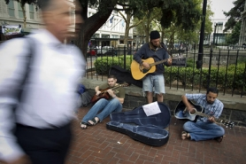 by: Christopher Onstott, A group of street musicians play outside Pioneer Courthouse, technically in a zone off limits to sidewalk sitting. Visitors to Portland complain that the city's street culture can be aggravating and threatening. Others point proudly to the city's tolerant makeup.