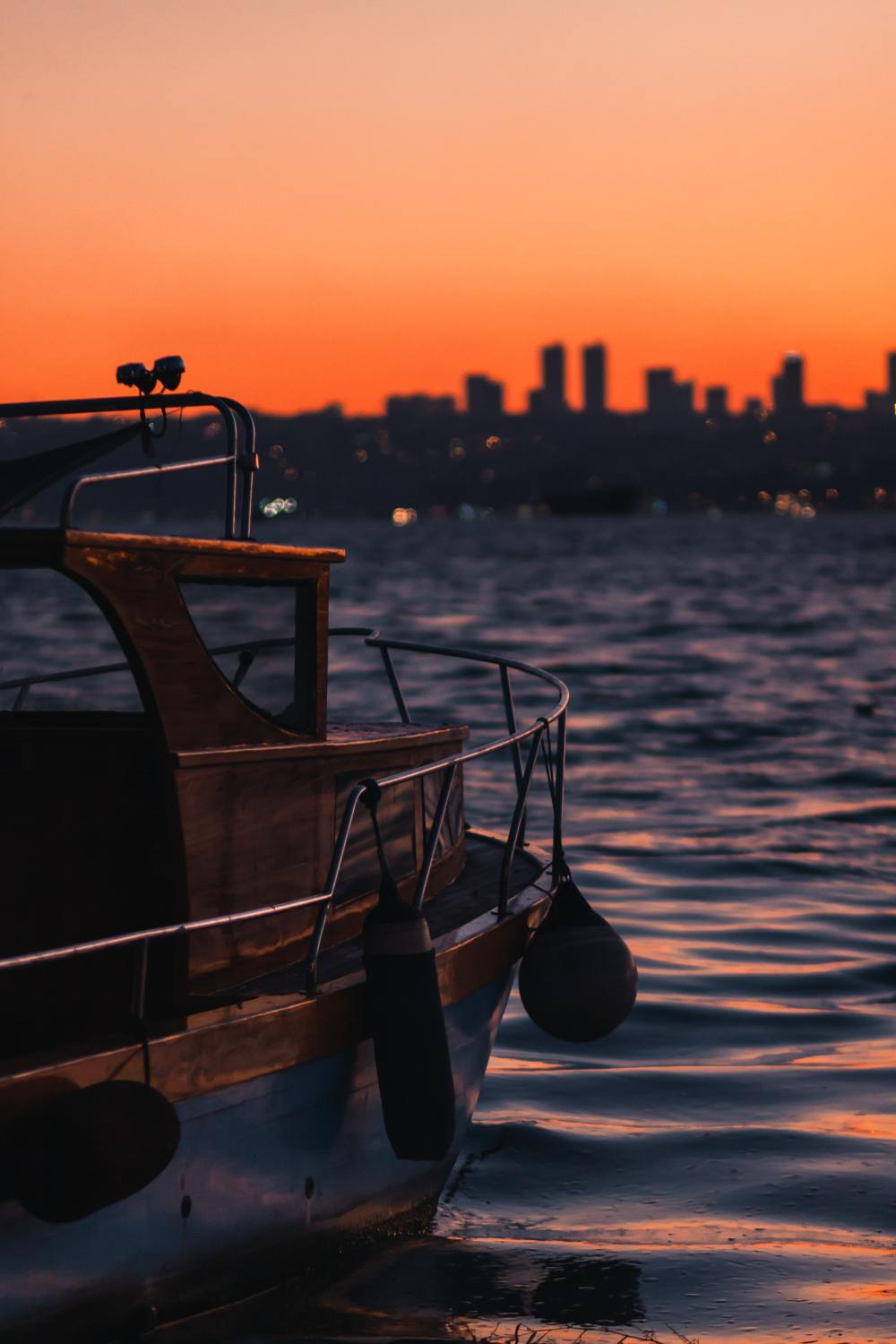 brown wooden boat on sea during sunset