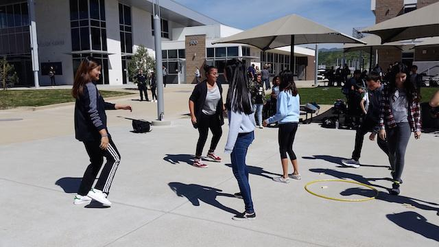 Students join together during intercultural week to play seven stones.