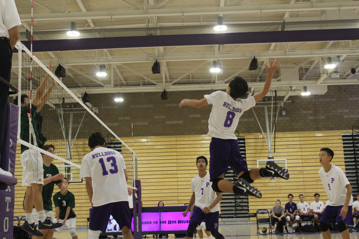 #8 freshman Andy Son jumps to spike a ball against Irvine High.