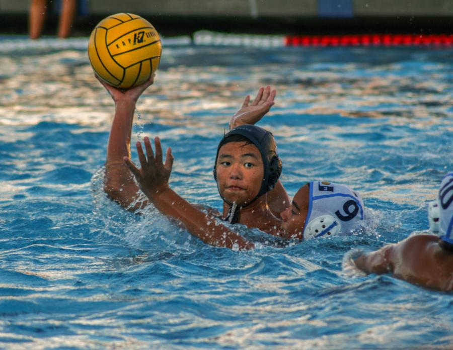 Flat and sophomore Taira Asakura looks to pass to wing and sophomore Dylan Gates on the right.