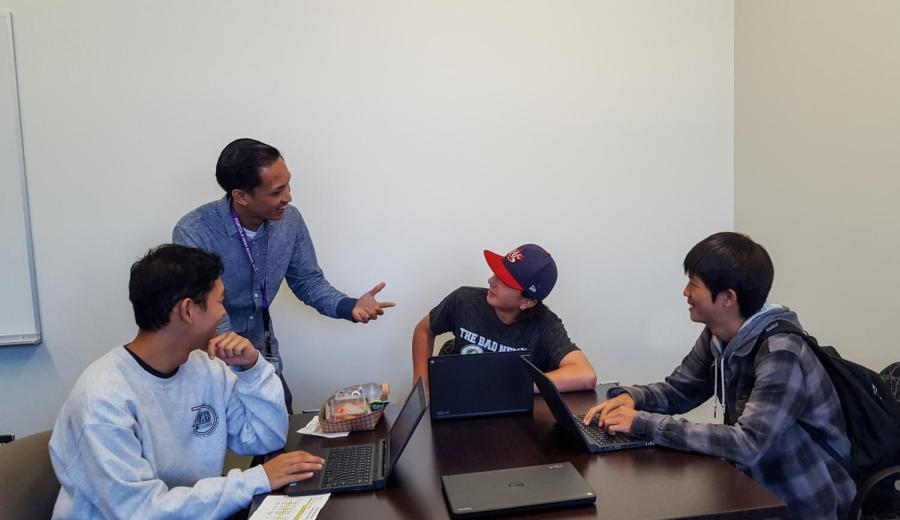 Ryan Itchon talks with students Brennan Sasaki, Tyler Sylvester, and Brendan Sung about Naviance.