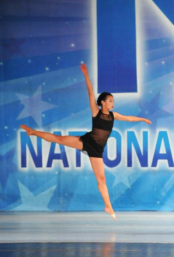 Katelyn Chin dances at KAR National Dance Competition, effortlessly jumping in a jeté.