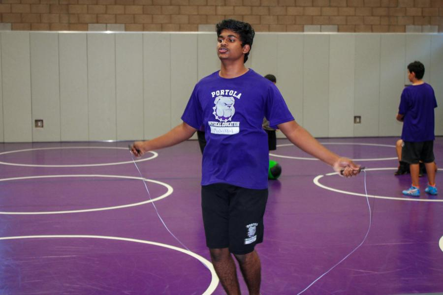 Sophomore Manimaran Muchikkal trains with his teammates during practice.
