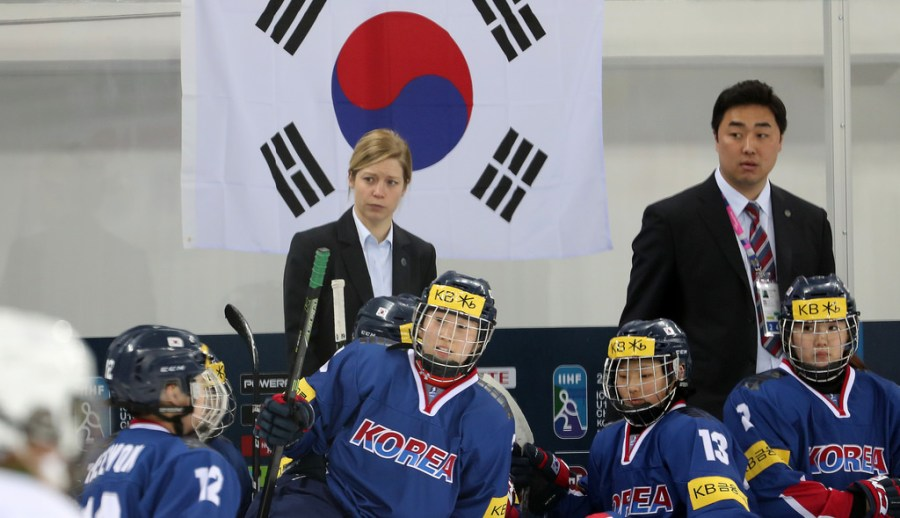 Former+ice+hockey+player+and+coach+Sarah+Murray+oversees+the+hockey+game+at+the+practice+Olympics+match+against+Sweden.+%0A