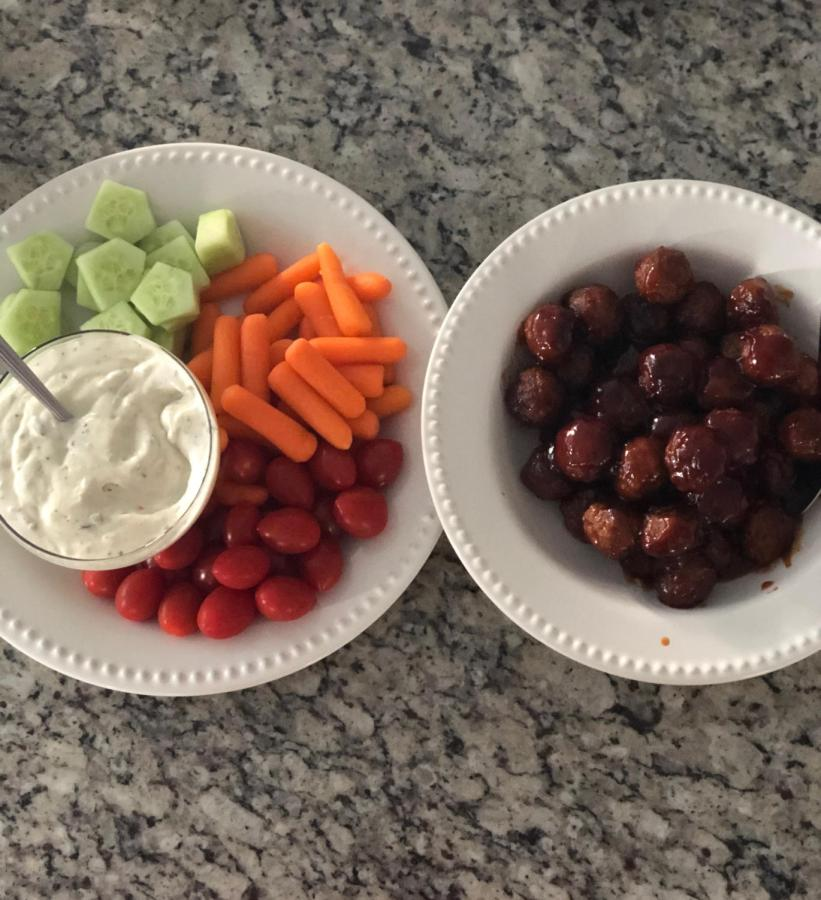 Finger foods such as vegetables and dip are usually found each year on family tables for the Super Bowl.
