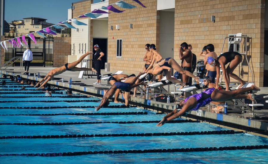 Lined up at the blocks, swimmers leap into the water and swim one lap of each stroke with 10 seconds between each set of swimmers.