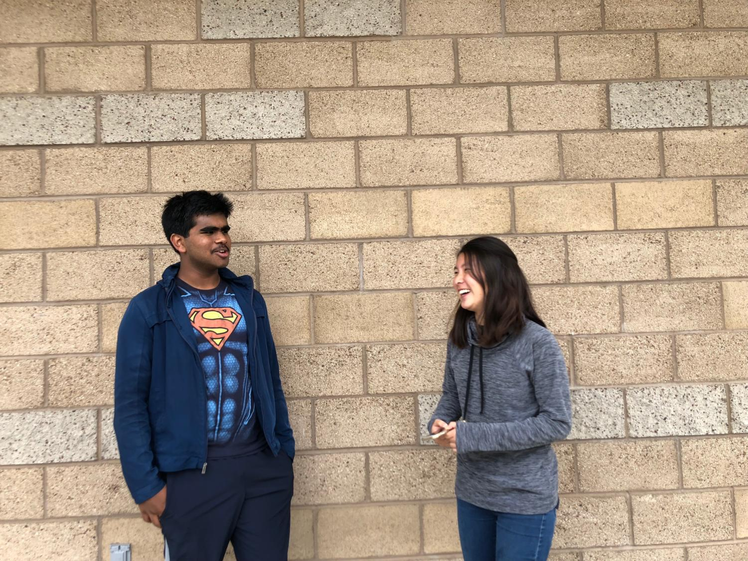 Sophomore Nishad Francis and freshman Kate Hayashi share a laugh as they discuss their differing views and recap on the year's memories.