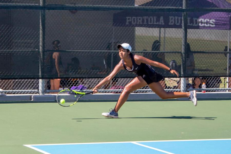 Just+getting+there+in+time%2C+freshman+Saachi+Pavani+returns+a+powerful+crosscourt+shot+to+win+the+point.