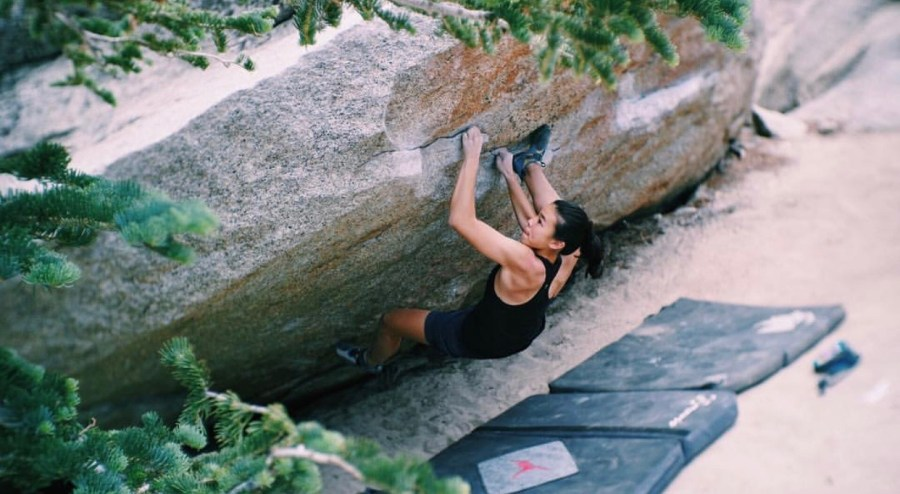 Sophomore+Phoebe+Yun+practices+bouldering%2C+a+type+of+climbing+that+requires+immense+physical+strength+to+complete+a+routine+on+a+boulder+close+to+the+ground+without+any+harnesses+or+ropes