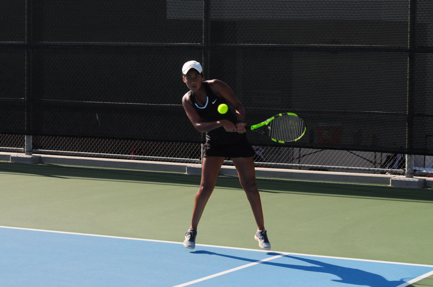 With determination in her eyes, Pavani swings a powerful backhand to launch the ball back to her opponent. Known by her teammates to be friendly and playful off the court, during matches, she develops a more serious and focused tone that reveals her competitive nature.