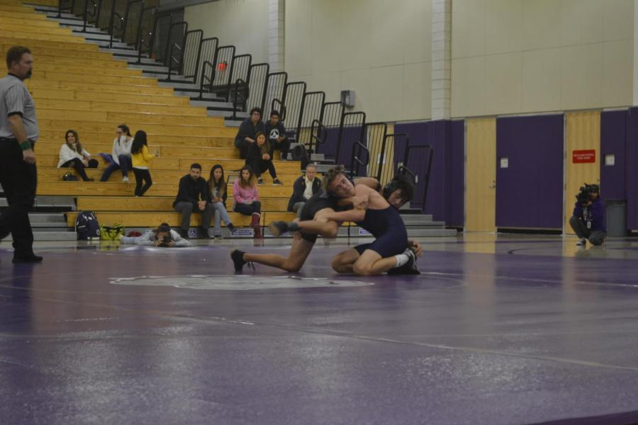 Sophomore Jackson Cooper performs a sprawl on his opponent in an effort to take him down.