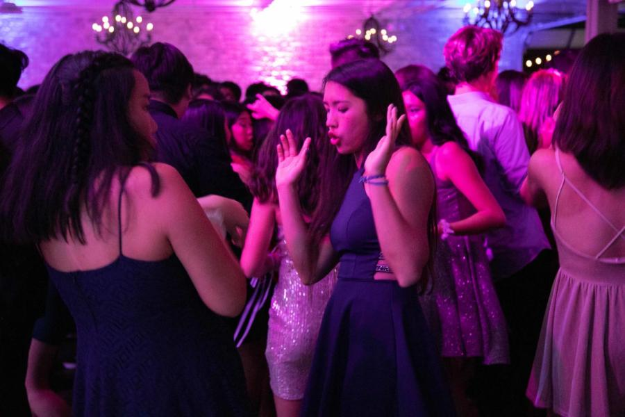 Sophomore Natalie Ng dances to hip hop music at the Fete. Over 500 students attended the dance, making it the most attended dance in school history.