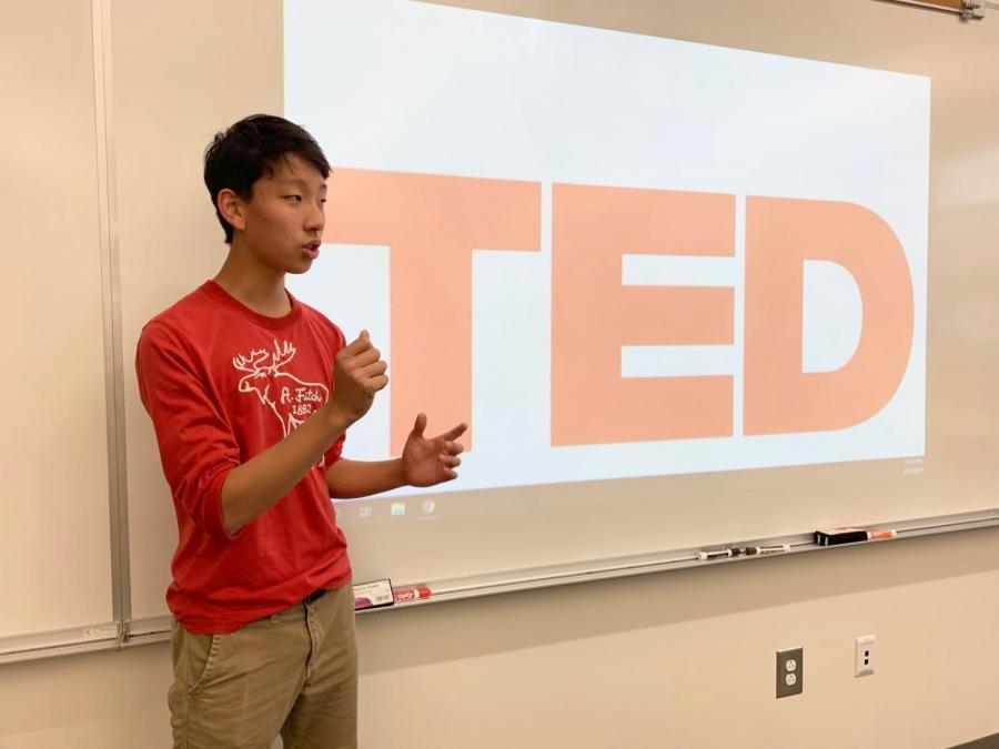 Freshman Kevin Lu rehearses his speech,