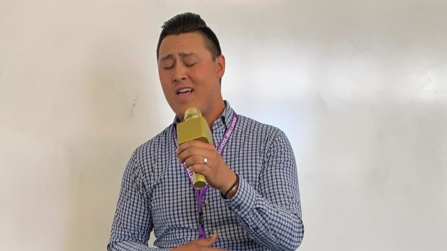 """English teacher Aaron Kwan performs Stevie Wonder's """"For Once In My Life"""" before his class, bringing his passions for teaching and singing together."""