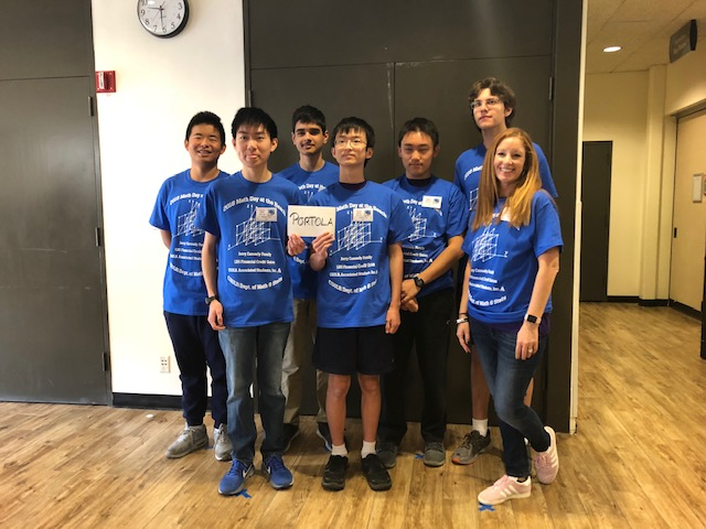 Club adviser Shelley Godett stands with (left to right) seniors Harry Song, William Hsieh, Nikhil Jha, junior Anthony Tan, seniors Joyee Chen and Nicholas Delianedis at the Math Day at the Beach competition.