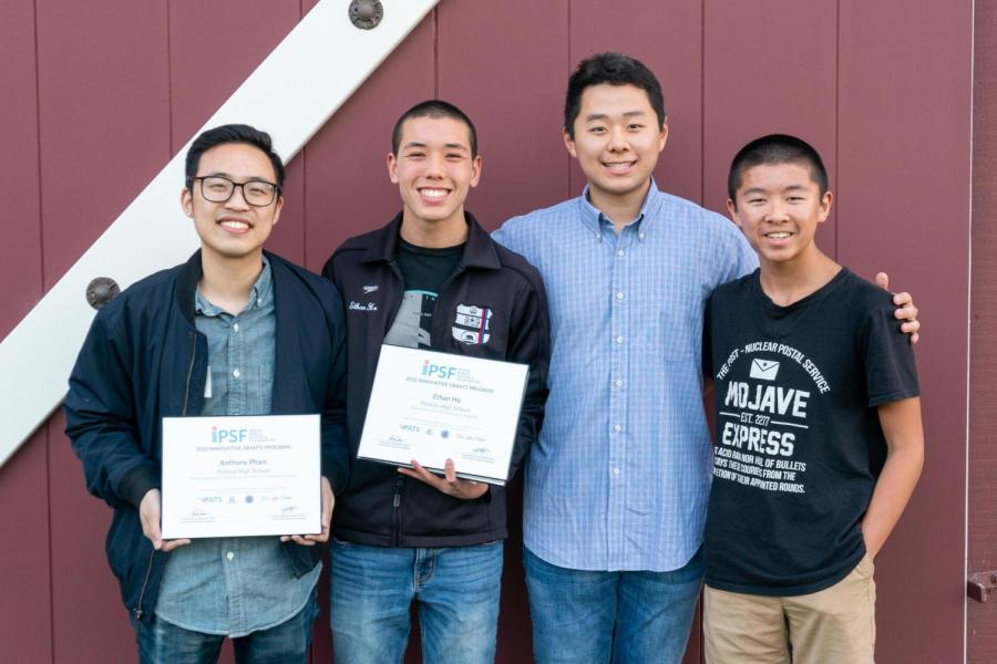 """Teacher Anthony Pham, senior Benjamin Kim and junior Ethan Ho show the award for """"Preparing Student-Athletes for the Next Competition: Esports."""""""
