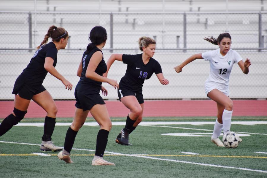 Junior Peyton Weidner sprints to intercept the ball and proceeds to score the first goal against the Vaqueros during the first half.