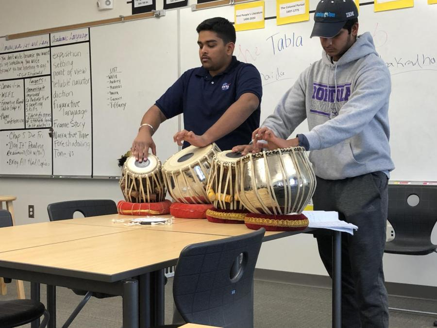 Club president and senior Harpreet Saluja and vice president and junior Yash Fatehpuria of the Tabla Club show their talents on the tabla, an instrument that has provided classic music for Indian culture throughout its history.
