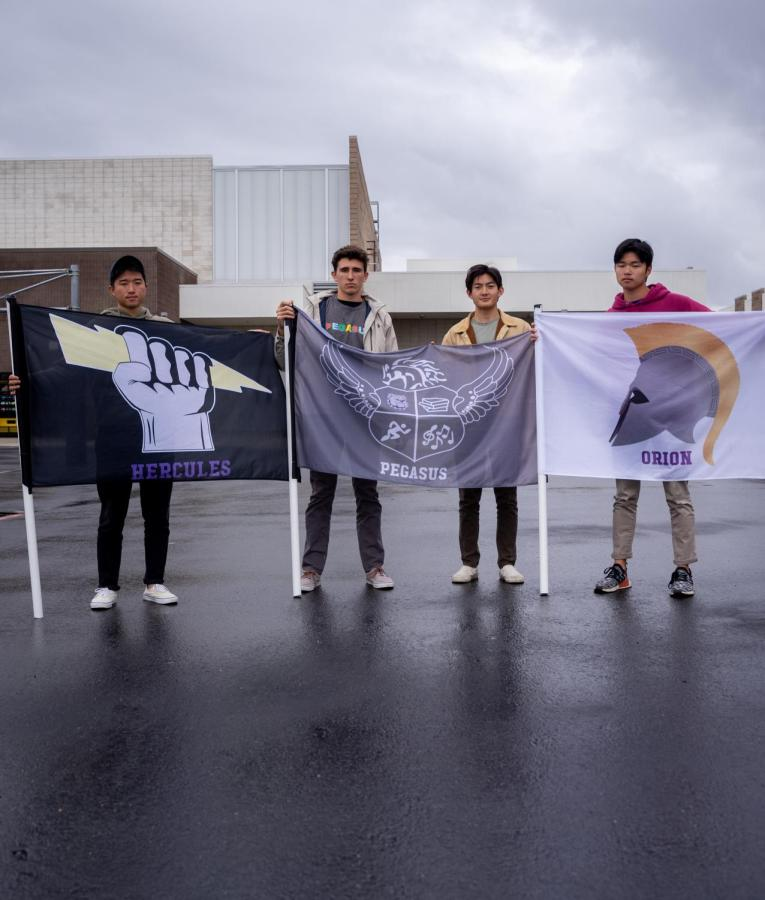 Sophomore Ryan Jung and seniors Kaveh Wojtowich, Matthew Vo and Taira Asakura hold their house flags as Portola's last house presidents before the transition to the class system.