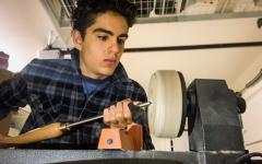 Ghafuri carves a bowl from a wooden block using a gauge, a tool used to make precise marks in wood. While he enjoys making bowls the most, he has also created letter openers and containers.
