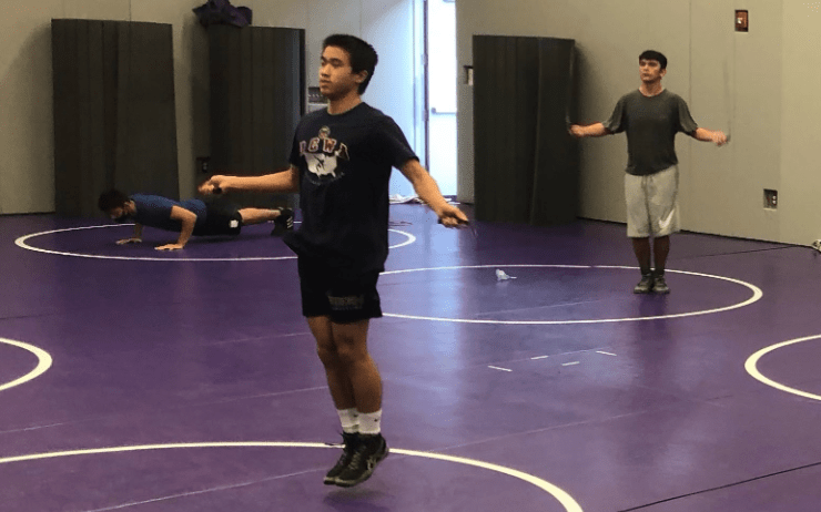 At socially-distanced wrestling practices, very few new freshmen join returning upperclassmen at daily after-school practice. New wrestlers have time to communicate and ask both athletic-and academic-related questions to their team as they wrestle against social distancing guidelines.